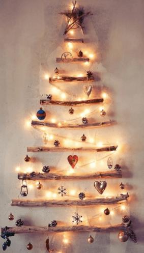 елка из веток на стене